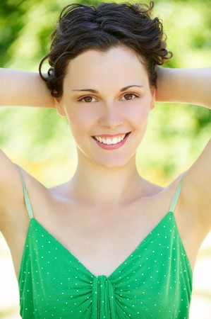 outside close-up portrait of beautiful young happy woman with fresh and clean skin photo
