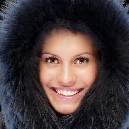 Beautiful girl in warm coat, isolated on black background. photo
