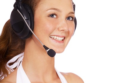 portrait of smiling girl in headset on white photo