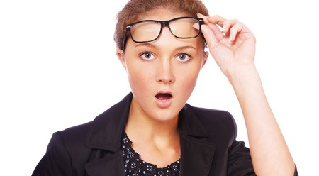 portrait of youn girl in glasses looking shocked Stock Photo - 8016570