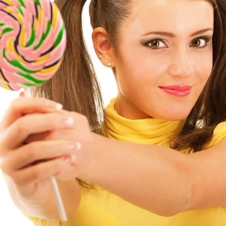 Girl with plaits holds lolipop, isolated on white background. photo