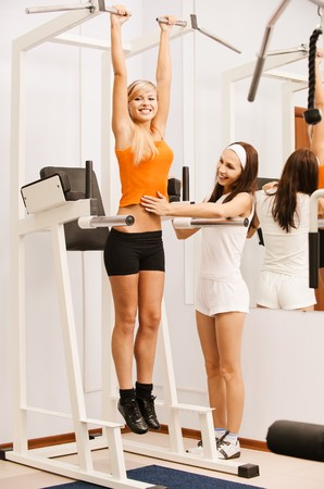 excercise: portrait of girl and her trainer working out on VKR