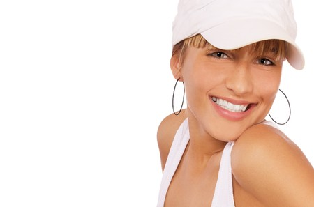 portrait of beautiful blond girl in baseball cap posing on white photo
