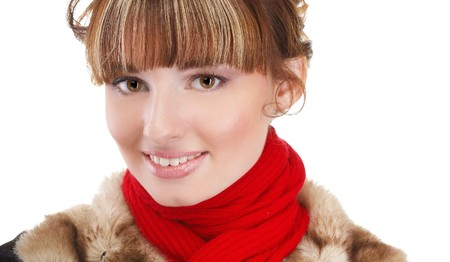 portrait of beautiful brunette girl in warm clothes on black photo