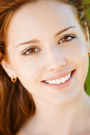 woman face close up: Portrait of beautiful smiling young woman with equal teeth close up.