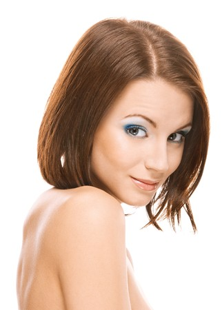 bared: Young beautiful woman with bared shoulders smiles, on white background. Stock Photo