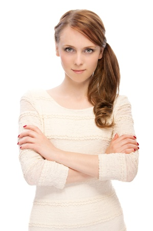 beautiful young  serious woman crossed her arms on a white background Stock Photo - 8823363
