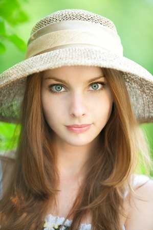 portrait of a beautiful girl in the hat on a green background Stock Photo - 8840548