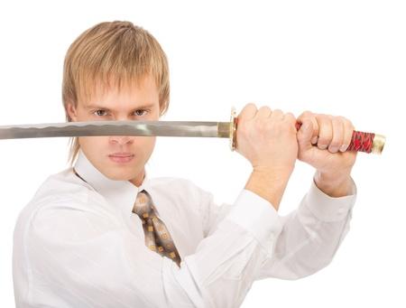 portrait of businessman in white shirt raising katana sword, on white background photo