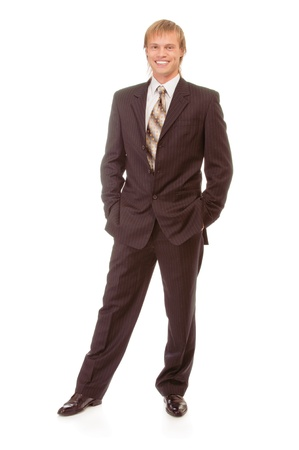 counterbalanced: full-length portrait of businessman in black suit, isolated on white background.