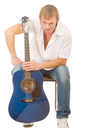 young blond man with a guitar, isolated on a white background photo