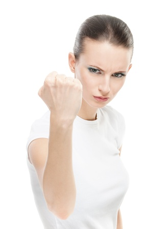 unfriendly: Young beautiful woman with a fist shakes, on white background.