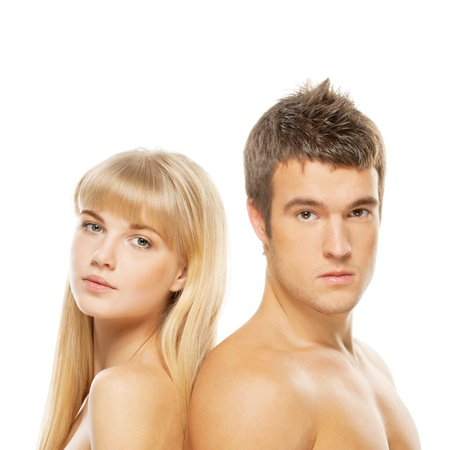 A beautiful young couple standing back to back isolated on white background. Stock Photo