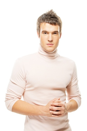 maglioni: portrait handsome young man in a sweater is isolated on a white background