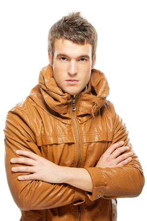 portrait of beautiful young man in a leather jacket, isolated on white background. photo