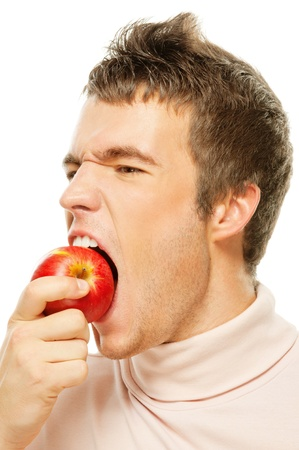 mordendo: Young handsome man is biting a red apple on his palm. On white background.