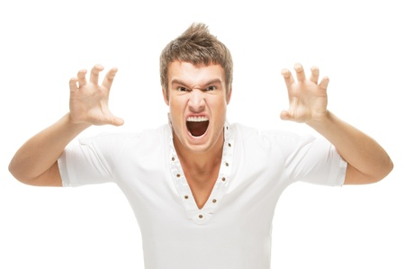 Irritated by a young man screaming in isolation on a white background photo