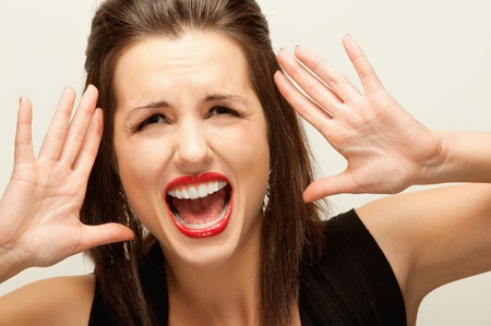 Beautiful woman has seized for head and loudly shouts. Stock Photo - 9340858