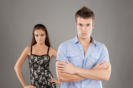 Young family couple has quarreled, on gray background. Stock Photo - 9412425