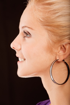 Portrait of beautiful woman in profile, isolated on black background. photo