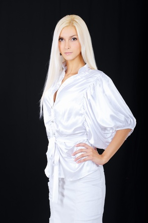 Charming blonde, isolated on black background. photo