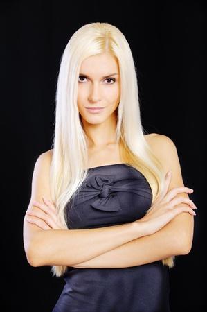 Beautiful blond girl, isolated on black background. photo