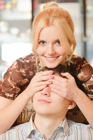 Beautiful blonde closes eyes to young man. photo