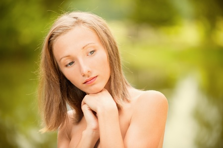 inclined: Young woman has inclined head and reflects.