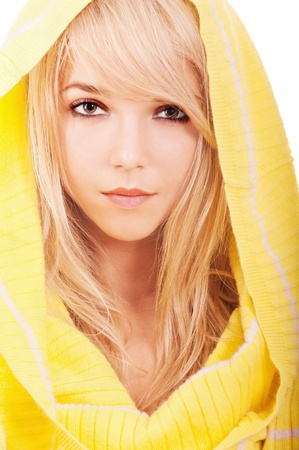 Beautiful young woman in yellow hood close up, isolated on white background. photo