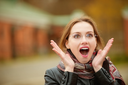 Portrait of beautiful charming woman in shock. photo