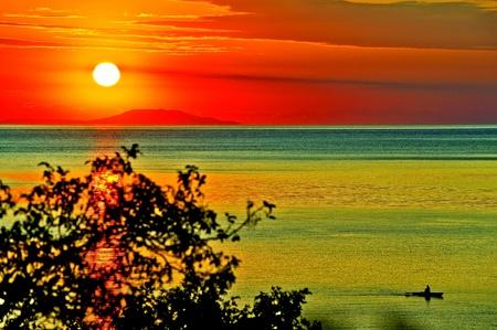 Dawn at sea coast summer at times. photo