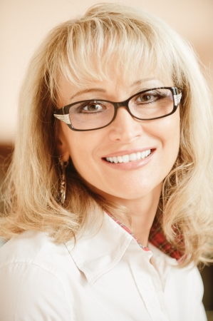 Portrait mature smiling business woman in glasses close up. photo