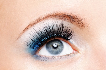 Front view of beauty female eye with blue make up it is large. photo
