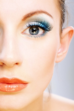 Half of face beautiful young woman with bright faultless make-up. Stock Photo - 9771158