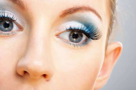 soiled: Eyes and nose of beautiful young woman close up, soiled by green cosmetics. Stock Photo