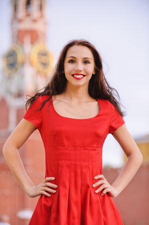 spassky: Young beautiful smiling woman against Spassky tower at Red Square in Moscow, capital of Russia.