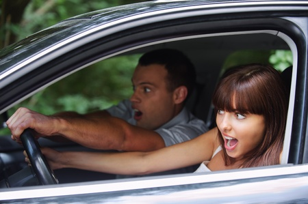 inexperienced: Young couple driving car on high speed. Stock Photo