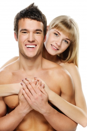 vigorously: Young happy couple: brunette laughing man and smiling blonde woman against white background.
