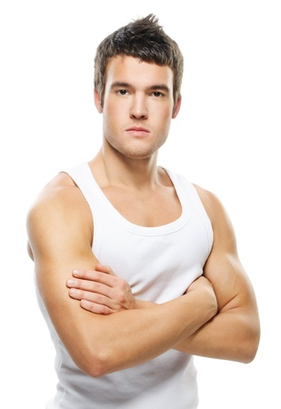 Portrait of young handsome brunette man wearing t-shirt against white background. photo
