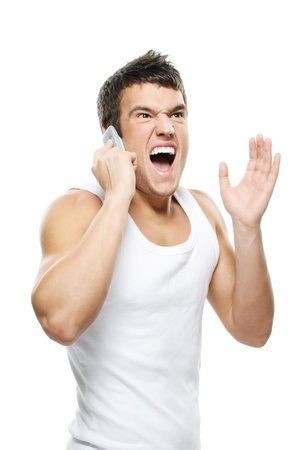 man phone: Portrait of young man wearing t-shirt, speaking on mobile phone and shouting against white background.
