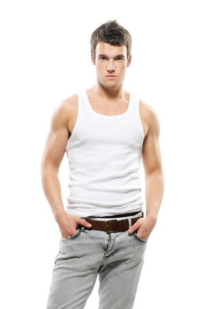 undershirt: Portrait of young attarctive handsome dark-haired man wearing t-shirt and jeans against white background. Stock Photo