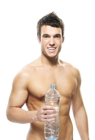 likable: Portrait of young attractive man holding bottle of water against white background.