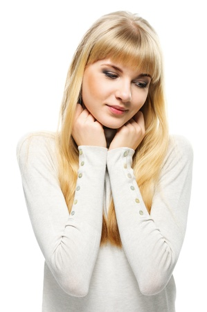 Portrait of young cute fair-haired woman wearing beige sweater against white background. Stock Photo - 10193979