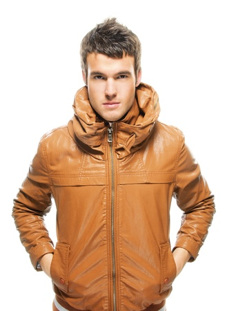 Portrait of young handsome serious man wearing leather jacket against white background. photo