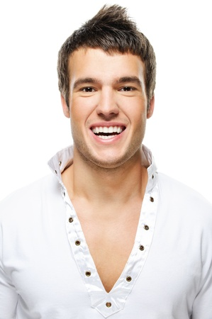 Portrait of young handsome brunette man laughing against white background. photo