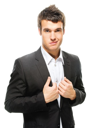 smirk: Portrait of young attractive dark-haired man wearing shirt and black jacket against white background.