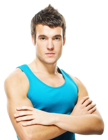 Portrait of young dark-haired serious man wearing blue t-shirt against white background. photo