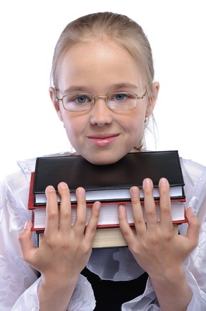 ravishing: Portrait of young fair-haired girl wearing blouse and eyeglasses, holding pile of books against white background.
