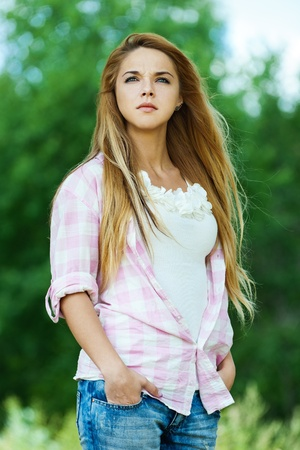 serious woman young beautiful park your hands pocket Stock Photo - 10653948