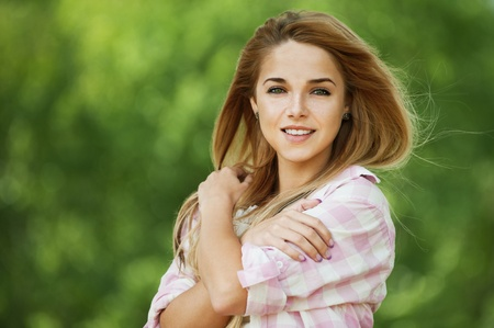 beautiful young woman long hair put hands shoulders smiling photo